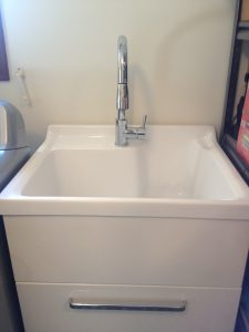 Laundry sink and faucet installed