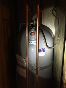 New 50 gal. Rheem hot water heater inside closet