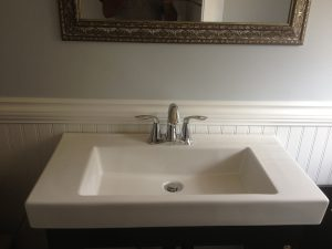 Moen bathroom sink faucet on Rona sink and cabinet