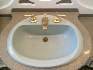 American standard basin with old faucet